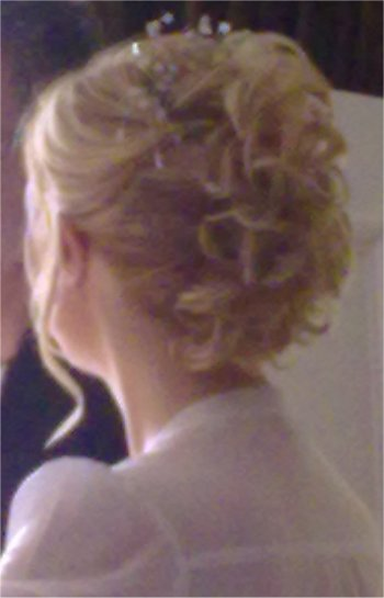 Wedding hair style using a curly clip in hair piece