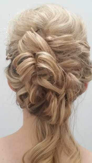 Soft vintage wedding hairstyle with rolls feminine and elegant