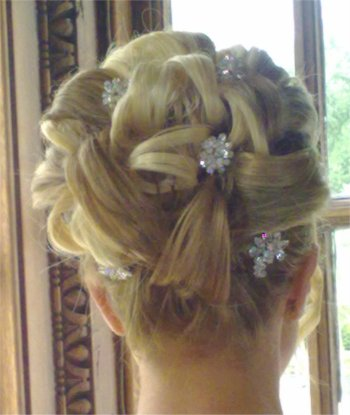Bridal hair up with barrel curls and two colour clip in hair extensions