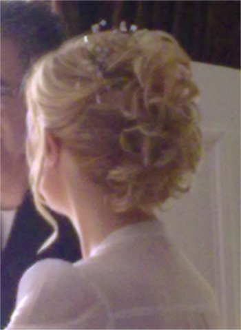 Bridal hair up curly with a hair piece