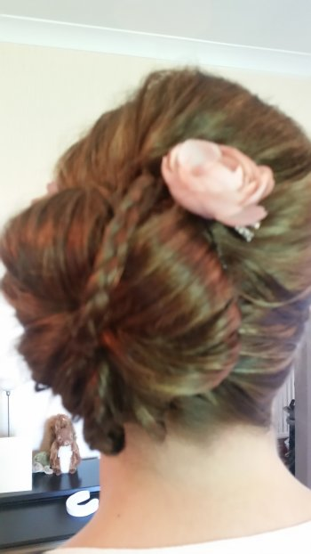 Bridal hairstyle up and plaited