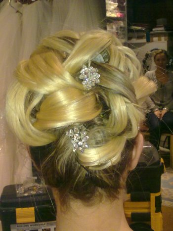 Wedding hair style with hair extensions and crystal hair pins