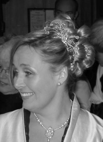 Wedding hair up do with a hairpiece