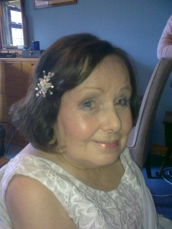 Mother of the bride hair style with sparkly hair grips