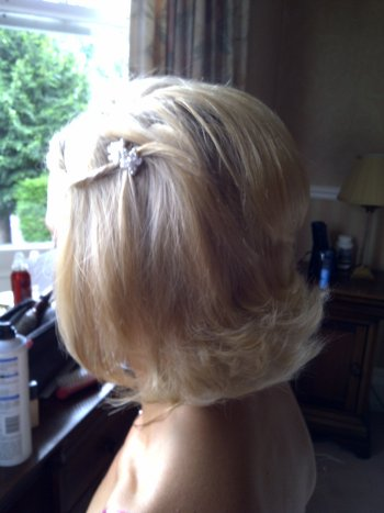 Wedding hairstyle for a short flicked bob