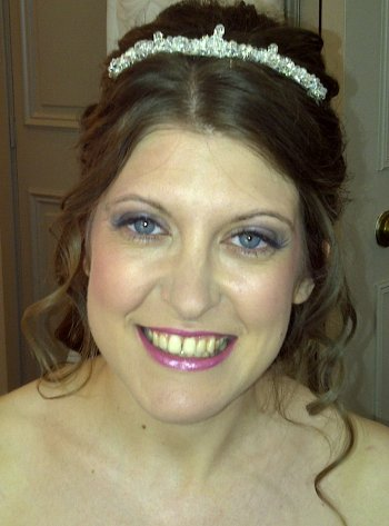 Wedding hair and makeup  with low silver. freshwater pearl and crystal tiara