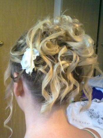 Bridesmaid hair up style with lots of curls
