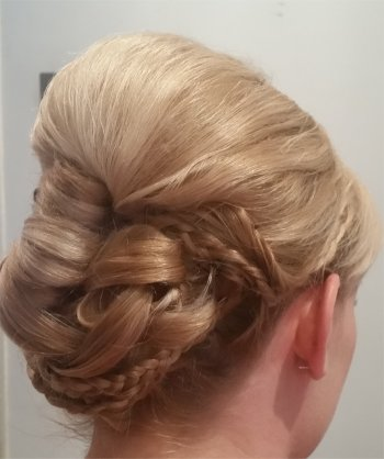 Vintage wedding hairstyle with plaits and rolls www.yourweddinghairandmakeup.co.uk