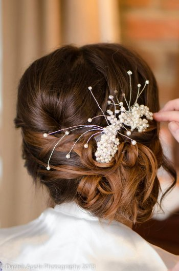 Stunning hair style for brides - hair up, feminine and sexy (Freshwater pearl hair pin www.irresistibleheaddresses.com 01403 871449)