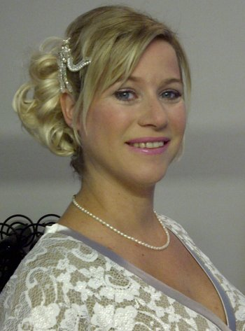 Wedding hair and makeup for a bride with short hair using a hair piece and crystal and pearl hair pins