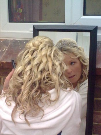 Curly wedding hair style using clip in hair extensions