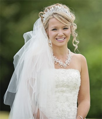 Curly up very natural wedding hair and makeup with crystal tiara and necklace